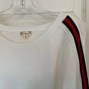 White sweater with red navy trim sleeve trim